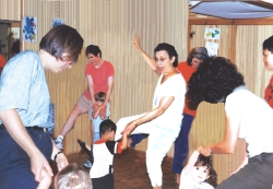 children dancing with adults
